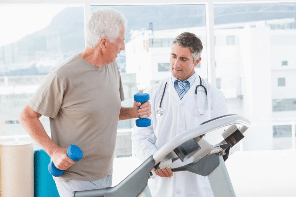 a senior man on a treadmill with a therapist for a physical exam