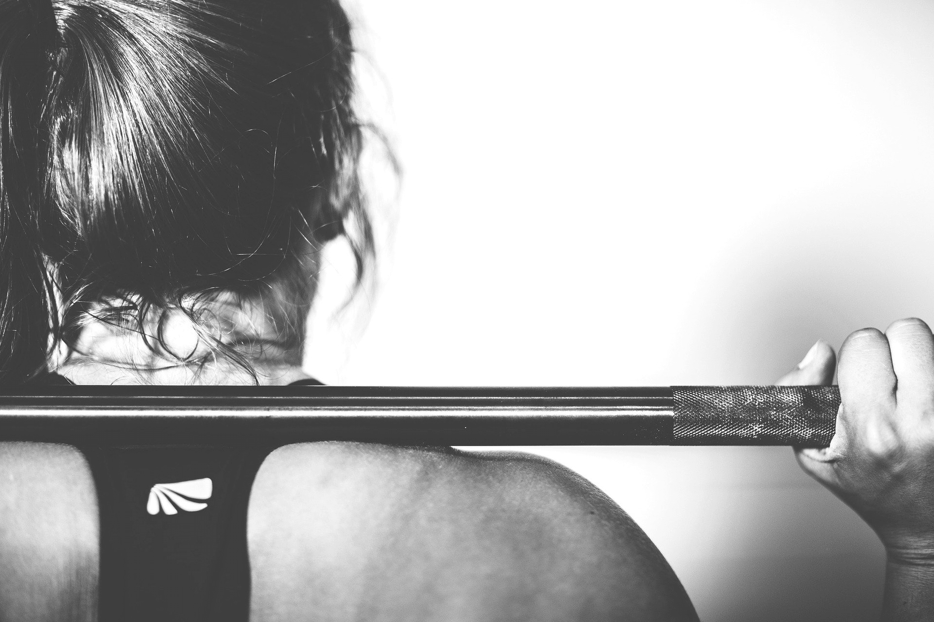A person with a barbell on their back