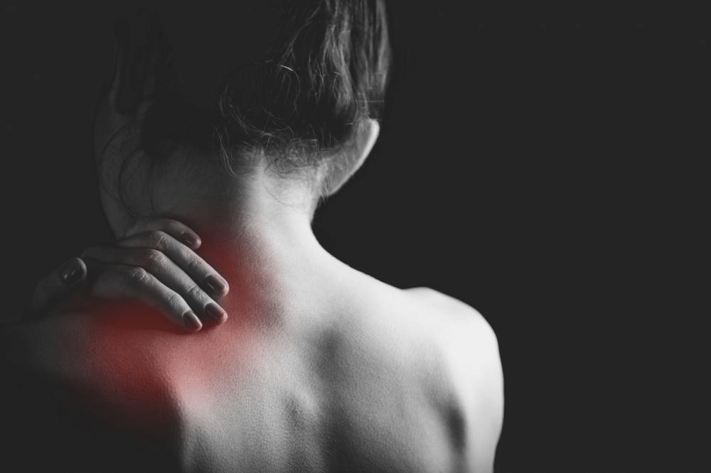 A woman with muscle soreness after exercise