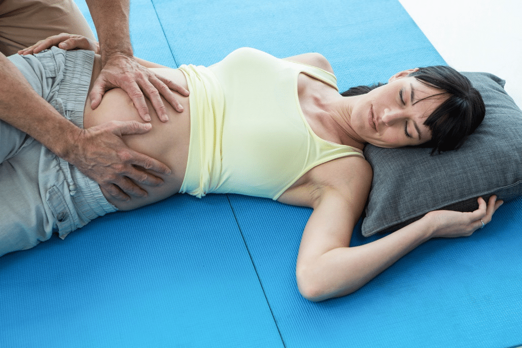 Pregnant woman getting a massage.
