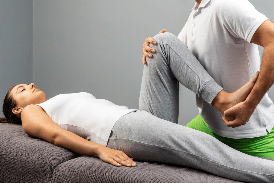 Woman receiving physical therapy.
