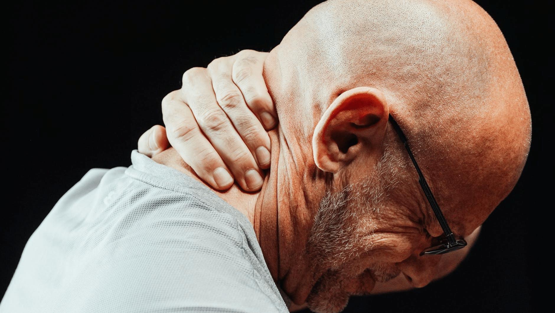 Man holding his neck