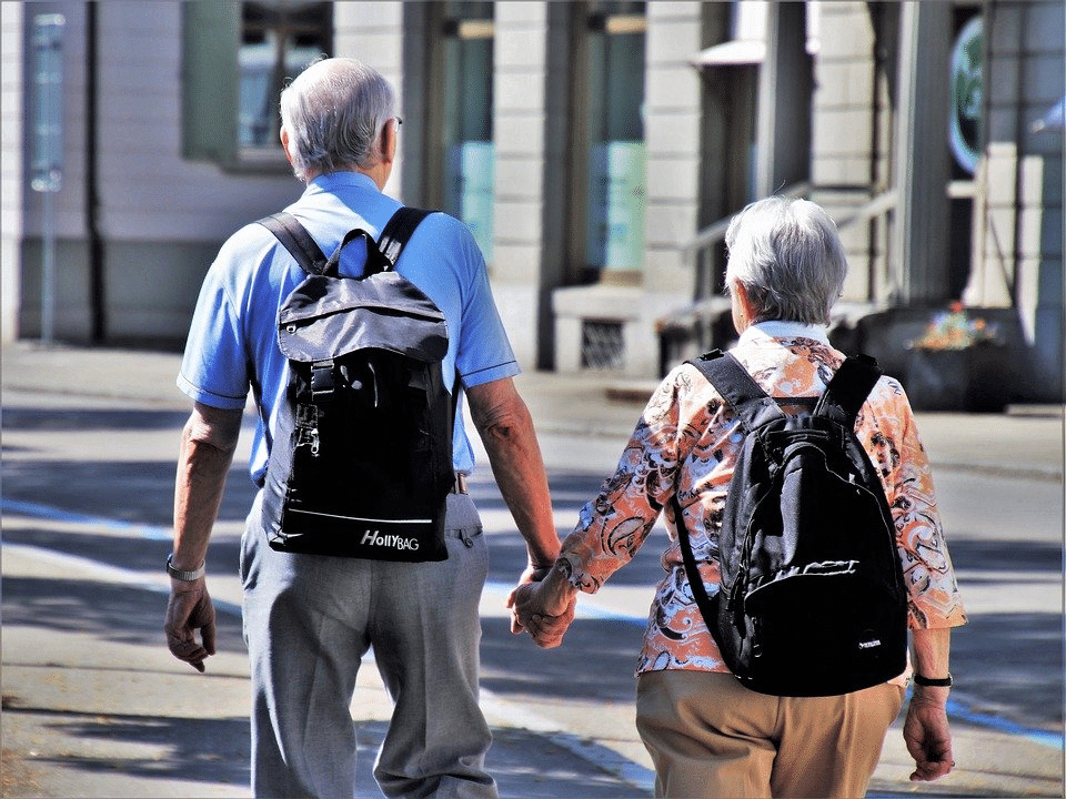 An older couple taking a walk together