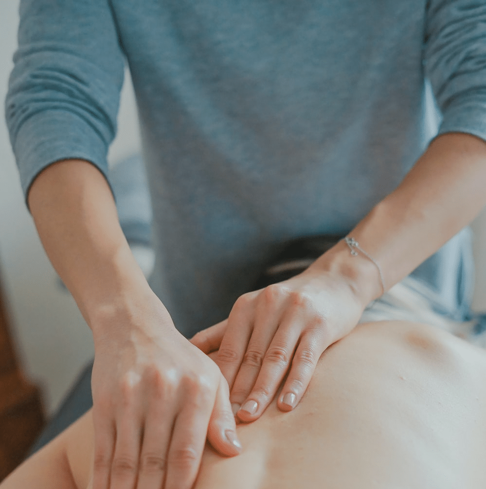 Physical therapist giving back massage
