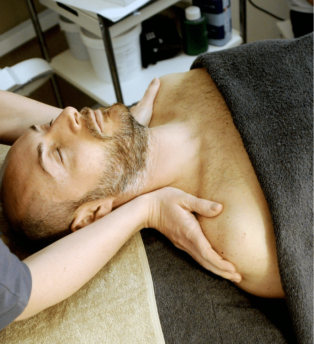 Physical therapist giving shoulder massage