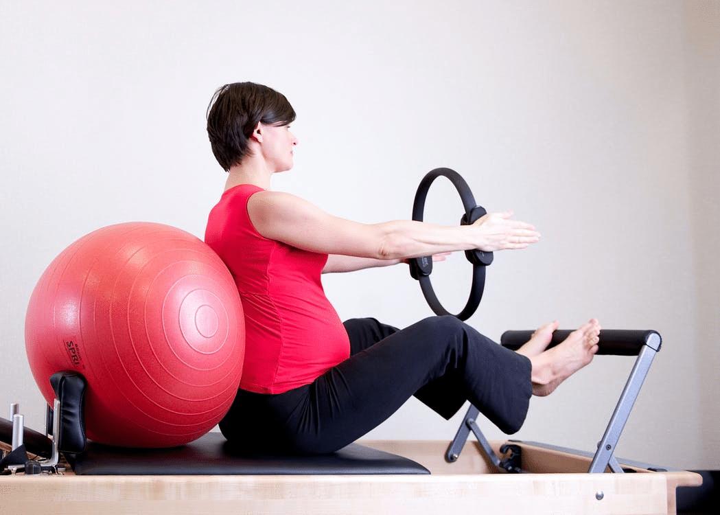 A pregnant woman exercising